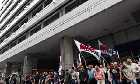 Protesters from the Communist-affiliated trade union PAME blockade the finance ministry in Athens