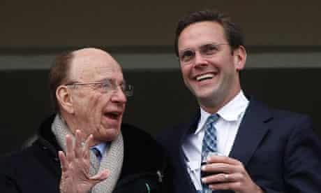 News Corp Chief Rupert Murdoch talks to son James Murdoch at Cheltenham Festival in Gloucestershire