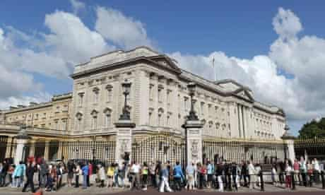 Tourists queue outside Buckingham Palace in central London