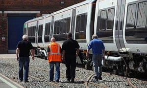 Bombadier workers at the Derby railway carriage factory, hit by news of the losss of 1,400 jobs.