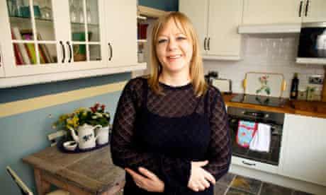Andrea Wren standing in her kitchen
