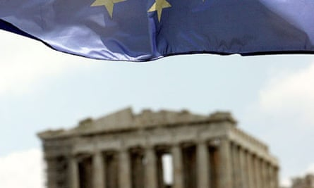 A European Union flag is flying over the temple of Parthenon on Acropolis hill in Athens