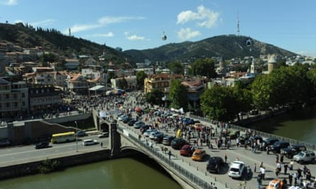 Georgians walk during the annual celebration in Tbilisi