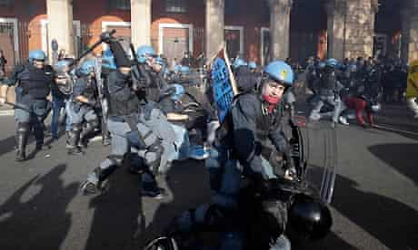 Riot police and protesters clash in Rome