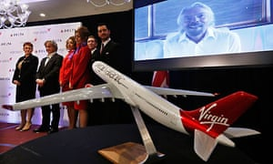 British entrepreneur Branson addresses a news conference via video to announce a sale, in New York