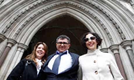 Property magnate Vincent Tchenguiz poses with members of his legal team at the high court in 2011