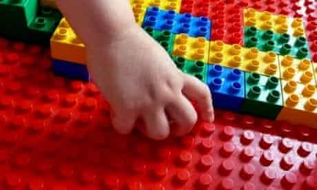Boy playing with Lego brick