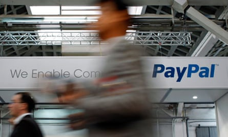 Visitors walk past an Ebay and PayPal banner at the Mobile World Congress in Barcelona
