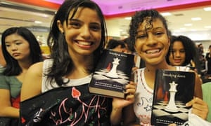 Customers buy the first Breaking Dawn books, the fourth and final instalment of the Twilight series.