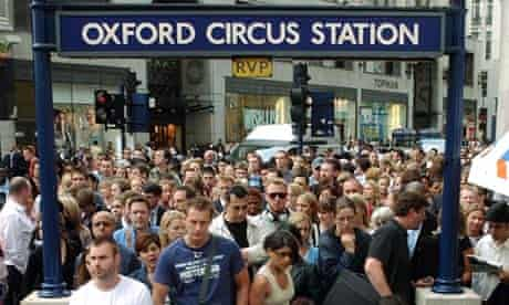 Commuters crowd the entrance to London's Oxford Circus underground station