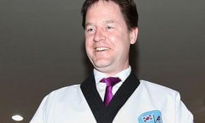 Deputy prime minister Nick Clegg wearing a taekwondo uniform in Seoul during a trade mission.