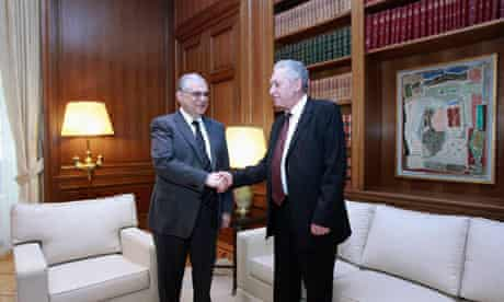 Greeck PM Lucas Papademos (L) and the head of the democratic left party Fotis Kouvelis in Athens