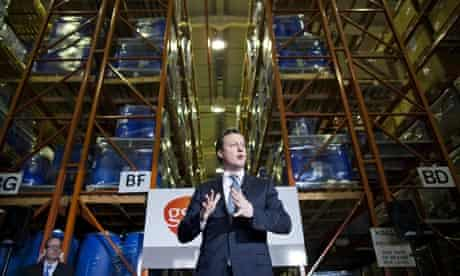 David Cameron visits a warehouse during a visit to GlaxoSmithKline's plant in Cumbria