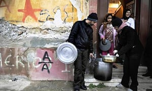 Soup kitchen activists deliver food to a poor area of Athens