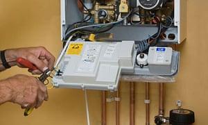 A man repairing a gas boiler
