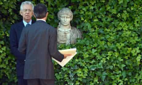 Italian Prime Minister Mario Monti (L)