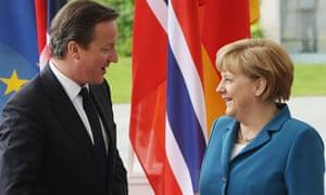 German Chancellor Angela Merkel greets British Prime Minister David Cameron in Berlin, Germany