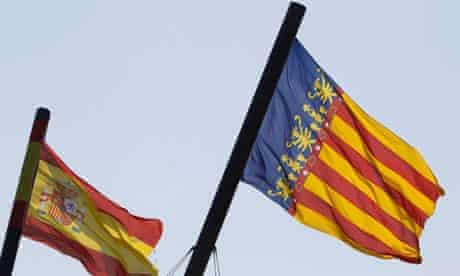 A Valencian (R) and a Spanish flag.