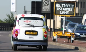 London taxi drives in an Olympic Lane near Heathrow Airport, July 2012