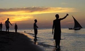Tanazania. A Dhow Sailing at Sunset