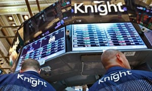 Knight Capital traders work at the company's kiosk on the floor of the New York Stock Exchange