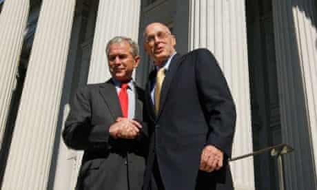 President Bush shakes hands with Treasury Secretary Henry Paulson, 2008.