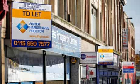 To let signs hang above shop fronts on a UK high street