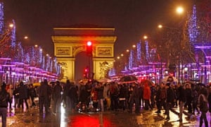 Revellers gather to celebrate the New Year in Paris, 2013
