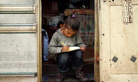 A girl in a Roma camp in Triel-sur-Seine, near Paris