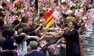 Tony Blair is greeted by supporters as he arrives in Downing Street as Prime Minister in 1997