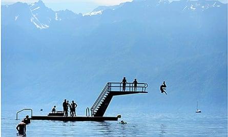 Children jump into Geneva Lake, Switzerland
