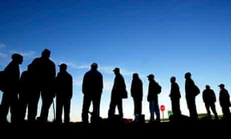 Jobseekers wait for work beside the road near Cape Town's Khayelitsha township