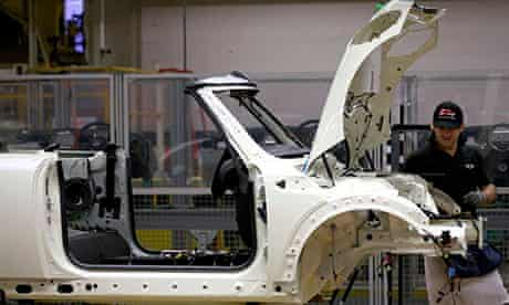 Factory workers produce Mini cars at BMW's plant at Cowley in Oxford