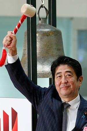 Japan's Shinzo Abe sounds a bell to mark the last session of 2013 at the Tokyo Stock Exchange