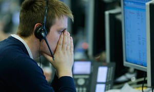 A broker at IG Index reacts as sterling tumbles