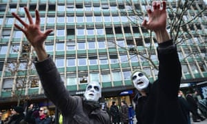 Opponents of Slovenia's pprime minister Janez Jansa wearing zombie masks, February 2013