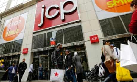 Shoppers walk past the J.C. Penney's store in New York