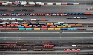 Containers and cars on freight trains at the railroad shunting yard in Maschen near Hamburg
