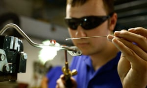 A worker brazes a component at manufacturing firm Sigma UK in Hinckley