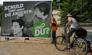 Workers set up an election poster of the Green party, Die Gruenen, for Germany's general elections