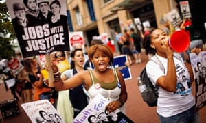 Workers' rights groups demonstrate in the street in front of Walmart offices, Washington, USA