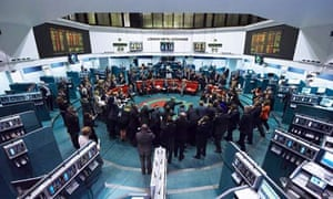 Traders work on the floor of the London Metal Exchange, London, England