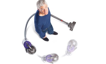 James Dyson with DC39 vacuum cleaner