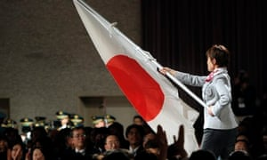 Flag-bearer and curler Ayumi Ogasawara of Japan at a send-off ceremony for the Sochi Olympics