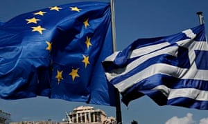 An EU and a Greek flag fly in front of the ancient Parthenon temple