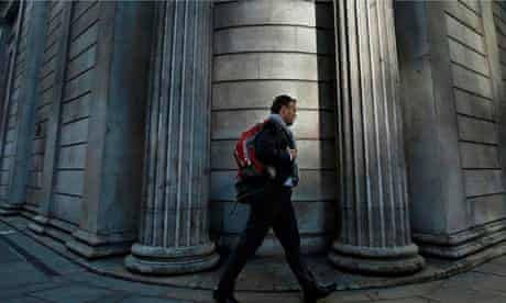 A man passes the Bank of England