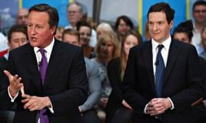 David Cameron and George Osborne speak together at construction company Skanska