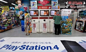 Games consoles from Nintendo and Sony on display in Tokyo
