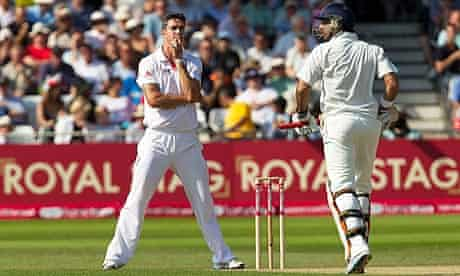 England's Kevin Pietersen, left, watches India's Youvraj Singh, whom he dropped, take a run