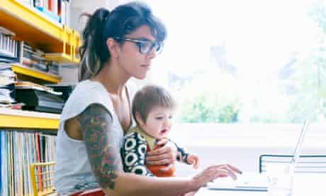 Mother with baby and laptop
